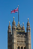 The British flag on top of Palace of Westminster - over the Victoria Tower.
