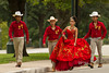 A very colorful group walking on the Texas Capitol grounds - some sort of photography session.  I like the fact that she is the only one who has spotted me.