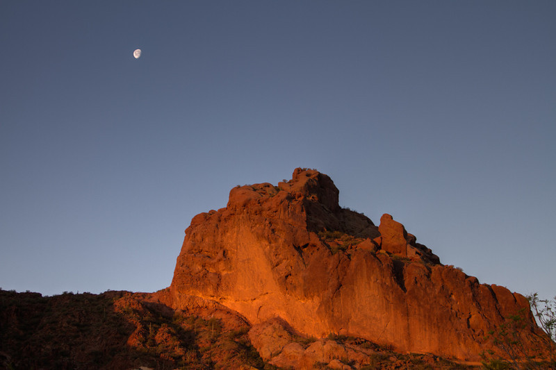 The full moon over Camelback Mountain in Phoenix AZ at dawn.