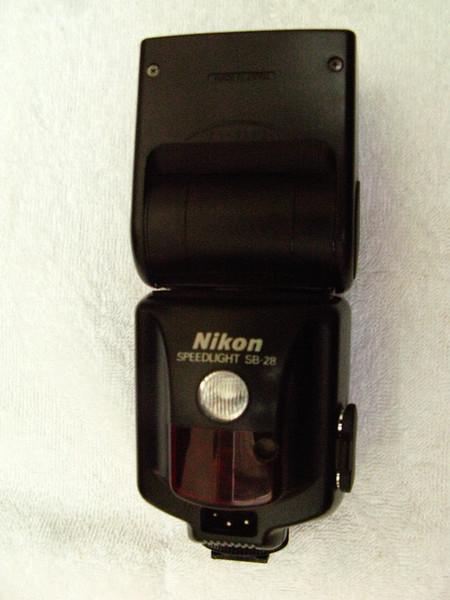 Nikon SB-28 flash gun, got it when I got my F5 body. Dont use it any more. Resting next to my F5.