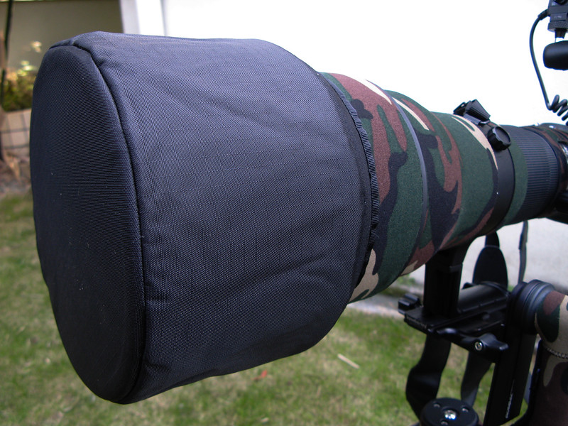 This is the lens hood that comes along with the Nikon 600mm f/4 lens. I generally carry this along with me and put it when am not shooting i.e when taking a break or when carrying around a mounted lens. Keeps the lens safe and protected. One can get hoodies from lenscoat optionally.