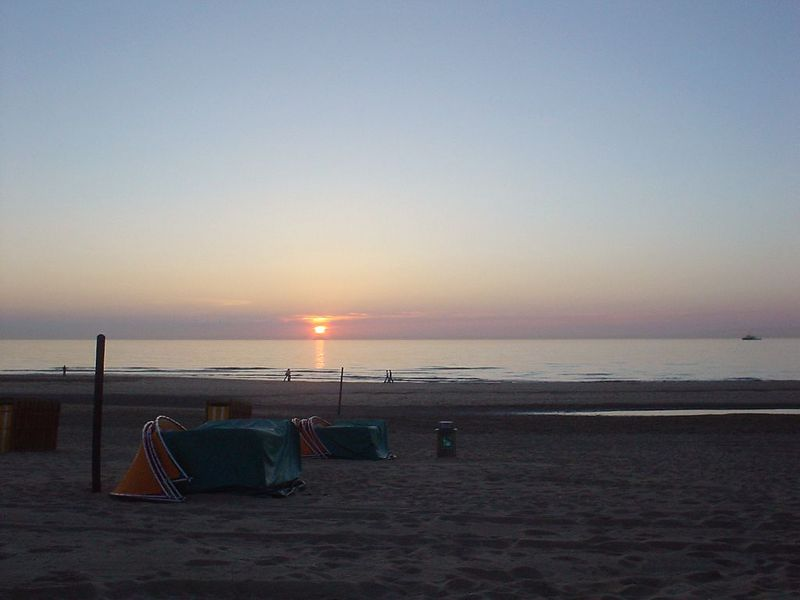 Sun setting from beach club Oase on the Noorderstrand, June 2003
