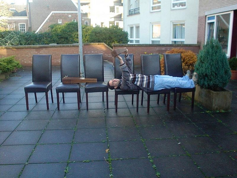 Funny sight of all my chairs outside. José Luis taking a break.
