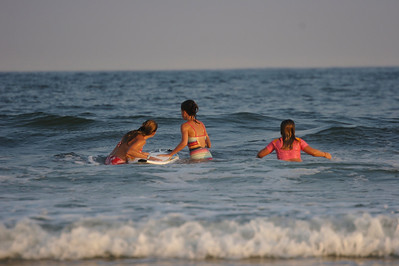 girls catching a wave