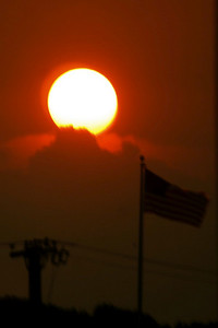 sun above flag at Rockaway Townsquare Diner