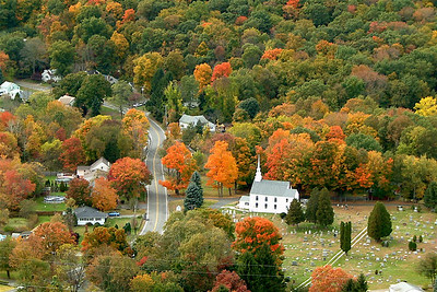 church in autumn foilage. a friend took this, but original pix was lacking.  i cropped and fixed color to bring it's true potential.