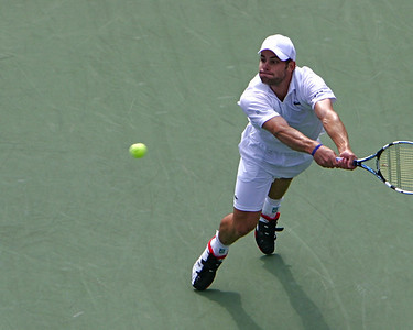 Andy Roddick reaches with a backhand