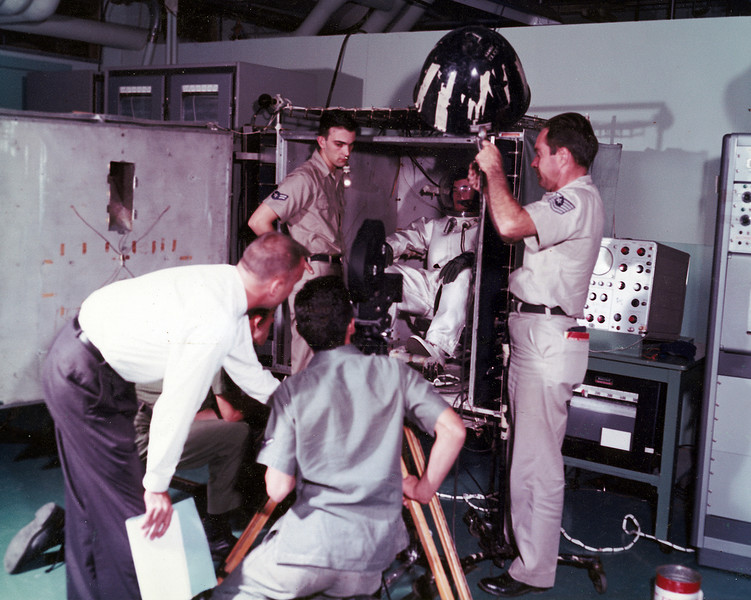 Wright-Patterson AFB, Ohio, John Thompson on camera, Mr. Wheeler with script, T/Sgt. Swanson holding light, me kneeling in background. 1962.