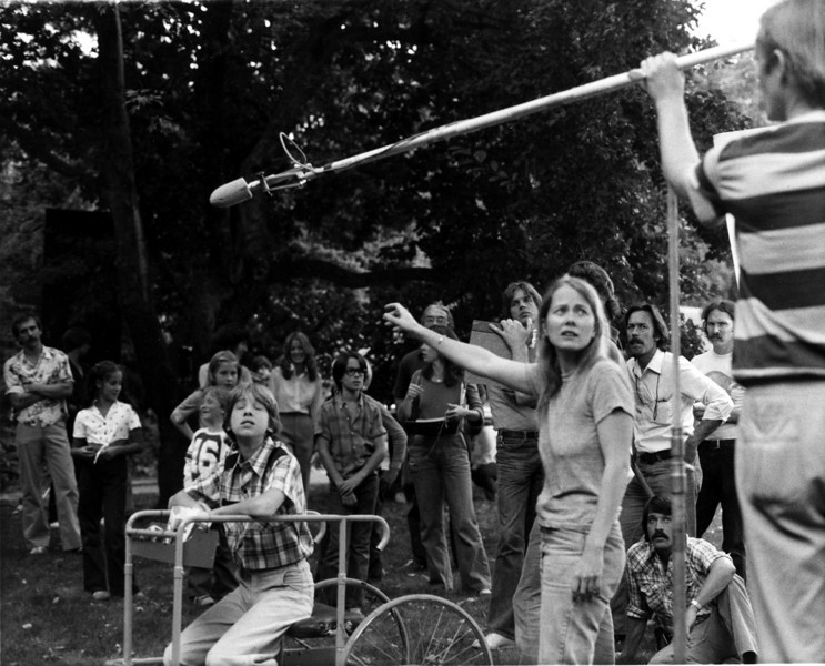 """""""Sam and His Cart"""".  Peggy Miles adjusts the audio as the rest of the crew waits.  Gary Moore on the boom, Daniel Hoffman, producer/director, sitting lower right. 1981<br /> Photo:  Photo: Laureen MacLeod."""