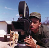 A/1C Richard Blakeslee filming at Lackland AFB, Texas.  Guard dog training film.  1963.