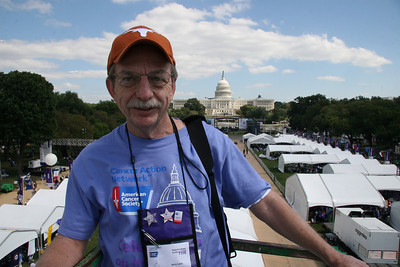 "Jerry Leist, riding an aerial lift used by the media, in front of the United States Capital Building, Washington, D.C.   This photo was taken during the American Cancer Society event ""Celebration on the Hill"" in Washington, D.C. This event took place in 2006."
