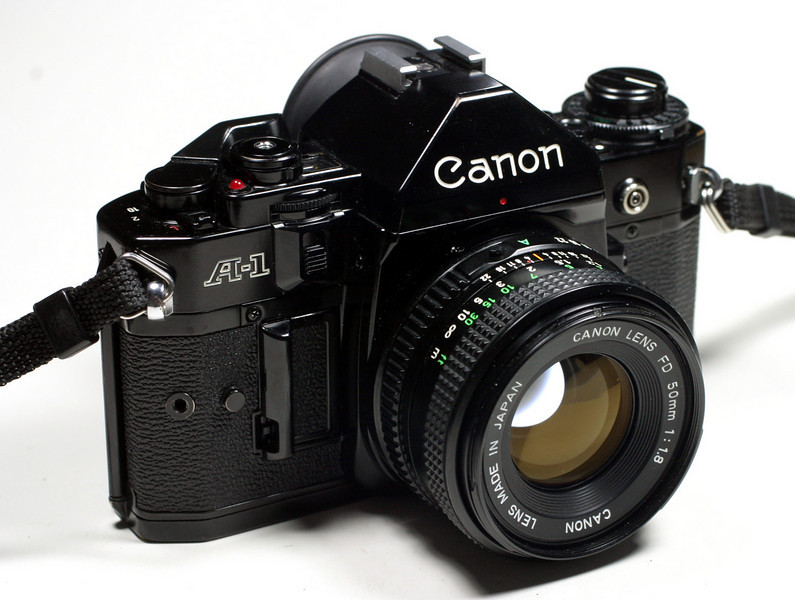 My first (analogue) SLR camera: The Canon A-1. <br /> This is 1978, folks!!! Clunky stuff. Built to last. This camera worked extremely well for me.<br /> It had cost me an arm and a leg and I was still a student at that time...... Go figure.<br /> Canon introduced this revolutionary concept camera that took the photographic world by storm.<br /> It was the first camera with a 7 segment red LED display in the viewfinder, showing shutter-speed, aperture and flash info. Amazing feature for that time....<br /> <br /> I bought the body together with the famous aspherical 50mm / 1.2 lens.... (that lens alone weighted over 1 kilo!! That's even more then the camerabody itself!!)<br /> Added a motordrive (5 fps !!!) and a Databack later. Awesome (but HEAVY)<br /> I (literally) sailed the seven seas, have travelled all around the world with this great machine. It NEVER failed in all those NINE years.<br /> My plan is to scan in some of the many (mainly) slides that I shot with it, <br /> and publish them on my site later on, time permitting of course..<br /> I sold this camera in 1987.