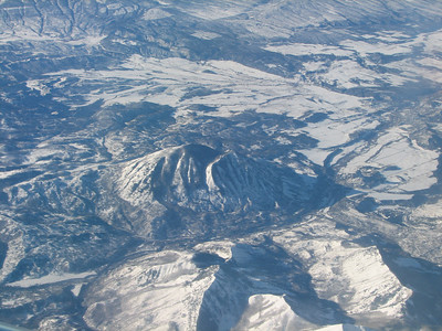 Snow covered mountains shot from my window seat.
