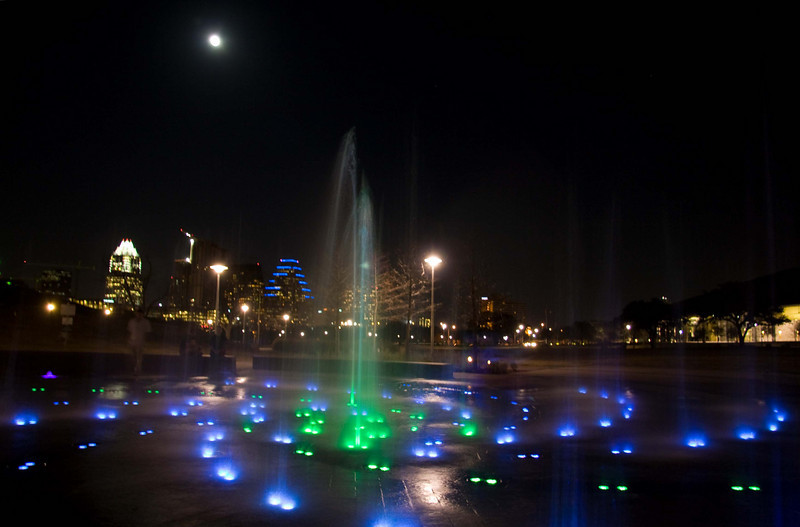 Austin skyline and water fountain just after dusk super slow shutter speed