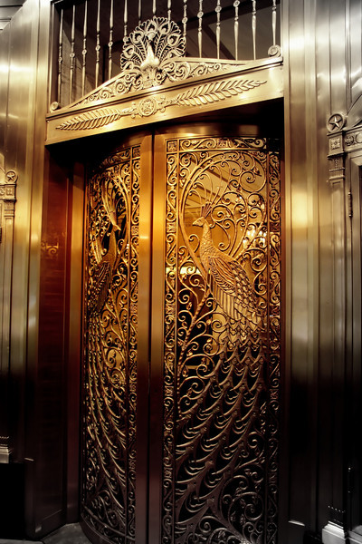 Beautiful peacock elevator doors from the Palmer House Hilton in Chicago...focal BW best viewed large..<br /> Happy Fall everyone!