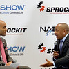 "Celebrity reporter Lee Hawkins interviews Daymond John from ""Sharks Tank"" at NAB (National Association of Broadcasters) Show from the Sprockit exhibit."