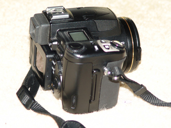 Camera Grip, Easy to grasp.<br /> <br /> What you see in the gallery is what will be included... <br /> Like New / Excellent Condition<br /> All the original components with the Camera<br /> Plus 128 CF Card<br /> Adobe Active Share<br /> Citadel Camera Bag<br /> Adapter Tube<br /> UV Filter<br /> 64 CF Card<br /> Photoshop Album,  will be included with the highest offer if over $600.<br /> May include PhotoShop Elements as well...<br /> Please e-mail me if you are interested.