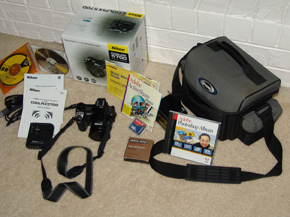 What you see in the gallery is what will be included... <br /> Like New / Excellent Condition<br /> All the original components with the Camera<br /> Plus 128 CF Card<br /> Adobe Active Share<br /> Citadel Camera Bag<br /> Adapter Tube<br /> UV Filter<br /> 64 CF Card<br /> Photoshop Album,  will be included with the highest offer if over $600.<br /> May include PhotoShop Elements as well...<br /> Please e-mail me if you are interested.
