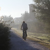 A bicycle and pedesterian only pathway along the Drava River Slovenia, with an early morning rider on a journey.  (Chuan)