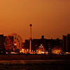 <h2>Coney Island Beach at Sunset - Brooklyn - New York City</h2> - By Vivienne Gucwa  Coney Island is the site of my favorite New York City beach. The Rockaways in Queens have become popular over the last few years and while I have fond memories of the Rockaways (since I grew up in Queens) Coney Island tugs at my heart in the best way possible. There is nothing like standing on the old pier that juts out into the Atlantic ocean while watching the waves crash onto the shore as the lights on the Wonder Wheel and the Cyclone twinkle in the distance like a tiny city of candles.  When I was much younger, I moved to New Mexico for a year and a half. I was in high school at the time and many fellow students would ask me what it was like to live so close to the ocean and I could never quite explain what it was like at the time. I was always at a loss for words. It was what I grew up with and it was hard for me to imagine life without access to the ocean.  Years later, it's still hard to fully put into words what it is like: breathing in salty ocean air, viewing the night sky while listening to waves, the feel of cool sand on bare feet, jumping through the ocean with wild abandon.   I think I keep taking photos in an attempt to further explain what the ocean means to me. Isn't that why we write, take photos, paint, dance, create music and engage in a variety of other artistic pursuits? It's to put into form those feelings and experiences that remain otherwise formless.  ---