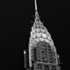 <h2>Touching the Sky - The Chrysler Building - New York City</h2> - By Vivienne Gucwa  If you are fortunate enough to look up at exactly the right time, you can catch the sun dancing along the top of the Chrysler Building. As the sun glides across the iconic spire, it leaves glimmering trails: shimmering footsteps connecting the sky to the city.  The Chrysler Building is a classic example of Art Deco architecture. Designed by architect William Van Alen for a project of Walter P. Chrysler, it was the headquarters of the Chrysler Corporation from 1930 until the mid 1950's. Even though the building was built and designed specifically for the car manufacturer, the corporation did not pay for the construction of it and never owned it, as Walter P. Chrysler decided to pay for it himself, so that his children could inherit it. Upon its completion on May 20, 1930, the added height of the spire allowed the Chrysler Building to surpass 40 Wall Street as the tallest building in the world and the Eiffel Tower as the tallest structure. It was the first man-made structure to stand taller than 1,000 feet.  ---