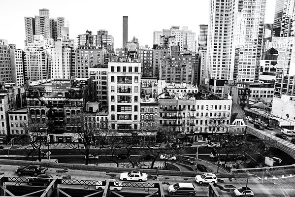 """<h2>Midtown Manhattan Skyscrapers and Streets from Above</h2> - By Vivienne Gucwa  I have been afraid of heights since I can remember. Even stepping on a tall foot stool would send me into a frenzied panic. It's partially a control issue and partially an irrational fear of the eternal """"what if"""" quandary related to my own mortality. And yet, I have discovered as I get older that there is something supremely thrilling about being high up above things especially being high up above New York City. It's the same scattered sense of adrenaline-fueled excitement I get when I consider the vastness of the ocean. And in some ways, I think both vantage points offer the same sense of displaced wonder.   A month or so ago, I watched an absolutely incredible video called Overview which examined something called the Overview Effect. """"The Overview Effect is a cognitive shift in awareness reported by some astronauts and cosmonauts during spaceflight, often while viewing the Earth from orbit or from the lunar surface."""" I can't recommend the video highly enough. It's a 15 minute short film that explores different astronaut's life-altering experiences viewing the earth from above for the first time. The footage of earth from above in the film is overwhelming. It's an emotional journey of a film that definitely has lodged its way into my consciousness. Here it is: http://vimeo.com/55073825  A few years back, when I went to the Top of the Rock, I had such an incredibly visceral reaction when I experienced seeing the city from above. It was rough for me to even take the elevator up 70 floors to the observation deck. I clenched my sweaty fists and closed my eyes the whole time deep breathing probably much to the amusement (or dread) of the fellow elevator passengers. Once I stepped out and onto the upper deck, I was hooked. It was as if I was seeing the city for the first time. Once you take yourself out and away from the streets that surround you, it's as if the city opens up its arms to y"""