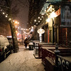 <h2>New York Winter Night - East Village Street in the Snow</h2> - By Vivienne Gucwa  On cold, beautiful winter night in New York City, snow covers the city streets of the East Village - a neighborhood in Lower Manhattan. Twinkling lights hang from snow-covered trees as a person makes their way through the snow during winter storm Nemo.  ---
