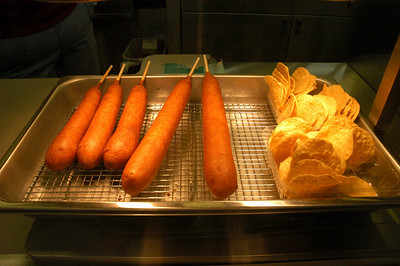 """""""Golden Trio, part three"""" Billy McKinney's footlong corndogs, front and center, at the Whiteside County Fair."""