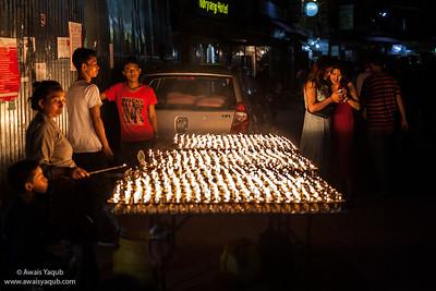 Ladies preview the photo in surroundings of Boudhanath, Budhist Stupa in Kathmandu