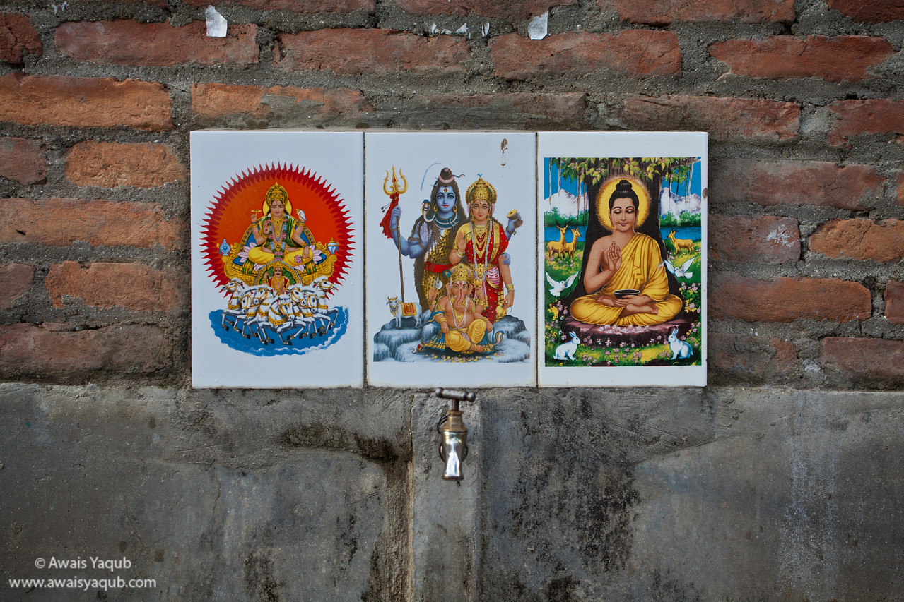 Water tap and religious figures