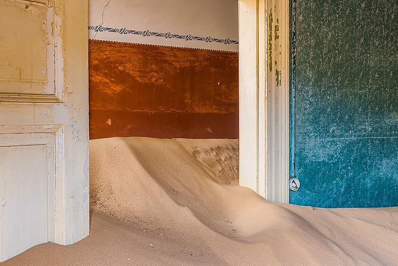 Nam 039  Doorway and Sand, Kolmanskop, Namibia