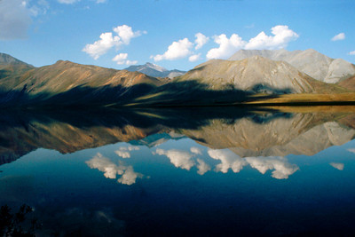 North America, USA, Alaska, ANWR, Shublik and Third Range Mts. and puffy white clouds reflected in Schrader Lake, July, 1990