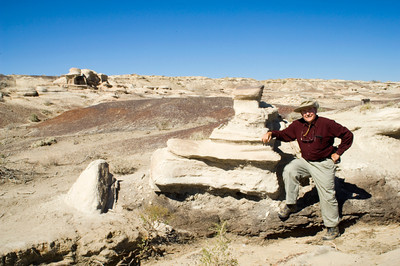 Man with Mushroom and Toadstool Formations in Bisti Wilderness Badlands, New Mexico