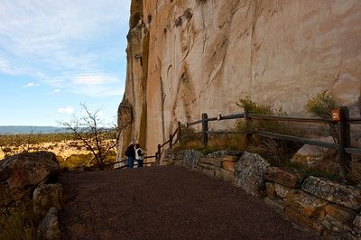 North America, USA, New Mexico, El Morro National Monument, Tourist Couple Examining Inscriptions