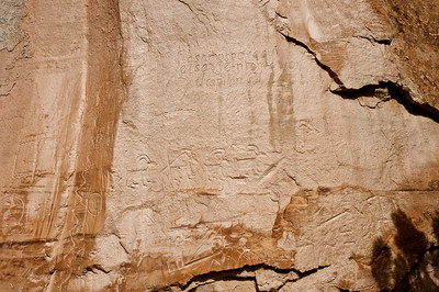 "North America, USA, New Mexico, El Morro National Monument, Bluff-side Inscriptions. Stop 11.  Inscription reads,  ""We, Sergeant Major and Captain Juan de Arechuleta and Adjutant Diego Martin Barba and Ensign Augustin de Ynojos passed by here, in the year 1636."" Indian petroglyphs below."
