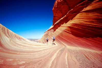 Two hikers in the Wave