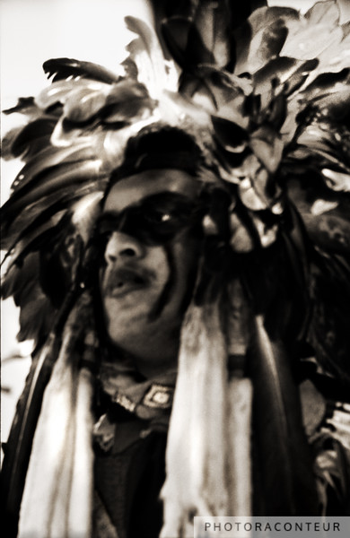 """""""Dog Soldier"""" ~ Native American wearing a Dog Soldier feather bonnet during a ceremonial dance."""
