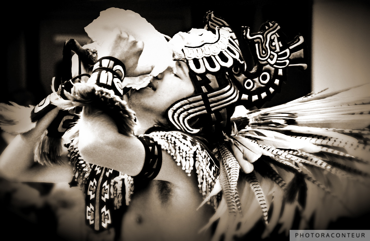 """Aztec Trumpet II"" ~ Aztec Fire Dancer wearing elaborate regalia while sounding an Atecocolli (conch shell trumpet) toward one of the four winds during a ceremony."