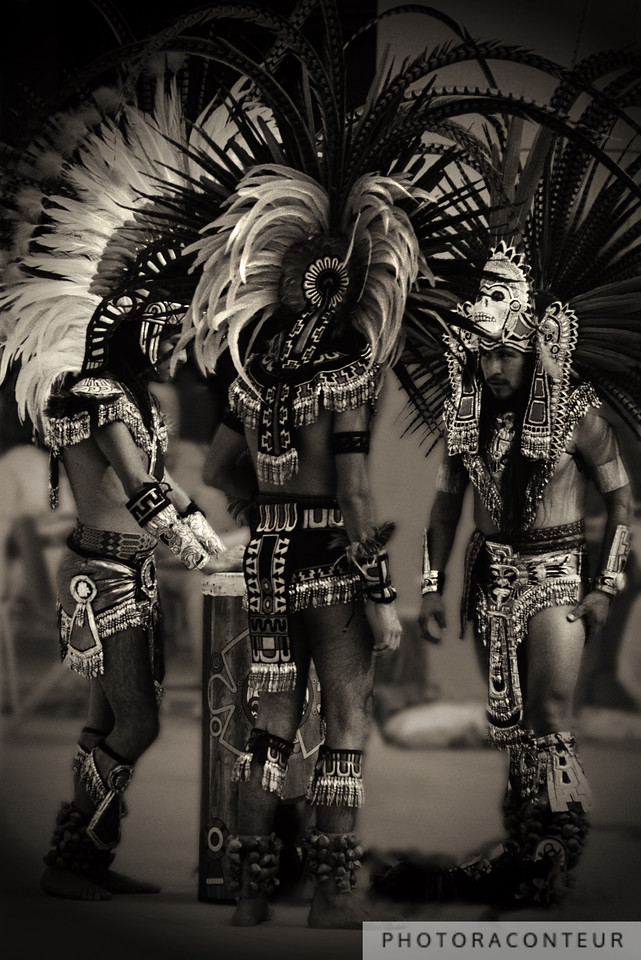 """Aztec Fire Dancers"" ~ Aztec Fire Dancers gather around the tlalpanhuehuetl (Aztec war drum) to prepare for their next ceremonial dance.<br /> <br /> (Photo by Benjamin Padgett)"