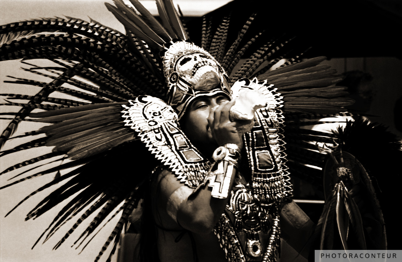 """Aztec Trumpet I"" ~ Aztec Fire Dancer wearing elaborate regalia while sounding an Atecocolli (conch shell trumpet) toward one of the four winds during a ceremony."