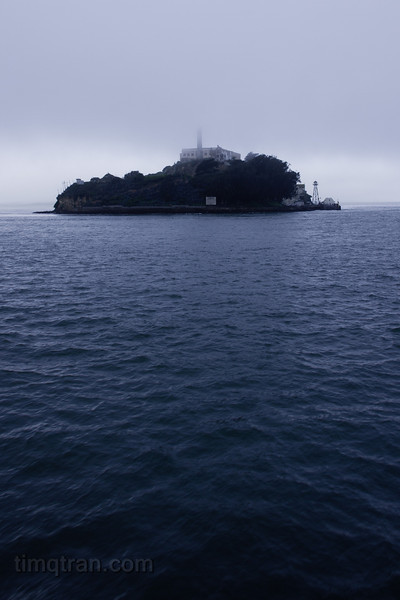 Alcatraz Island peeks out from the mist of San Francisco Bay.