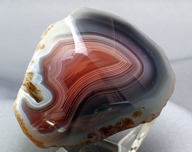 4oz Botswana Agate; 5.8cm x 4cm x 4.3cm.   Again, highly reflective - assorted items on my photo table can be seen in the rock!