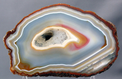 Another Brazilian agate; 19cm x 11.7cm x 4.4cm.   Very colorful and it would seem the rock's natural colors as none are predominant. That's usually the first sign of a dyed or baked rock.  By the way, this rock is not face-polished. I have a slice of this same rock that was polished. It's quite unusual to get both a slice and the original rock it came from.