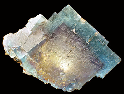 The same fluorite, but lighting from below (inside), which provides a more clear view of the octahedra cubic shapes.