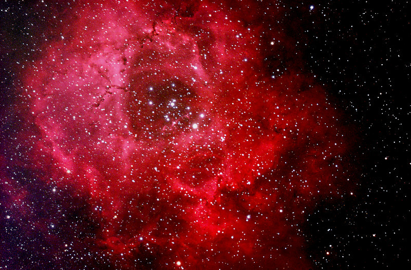 The Rosette Nebula is a large, circular H II region located near one end of a giant molecular cloud in the Monoceros region of the Milky Way Galaxy. The open cluster NGC 2244 is closely associated with the nebulosity, the stars of the cluster having been formed from the nebula's matter.The cluster and nebula lie at a distance of some 5,200 light years from Earth (although estimates of the distance vary considerably) and measure roughly 130 light years in diameter. The radiation from the young stars excite the atoms in the nebula, causing them to emit radiation themselves producing the emission nebula we see.<br /> ***********************************************************************************************************<br /> Captured using:<br /> Camera: OSC QHY8 as main and QHY5 as guide<br /> Filters: Ha 7nm, Moon&Skyglow + Fringe Killer<br /> Scope: WO FLT-110 f/7 and SW 80mm as guide<br /> Mount: HEQ5 Pro<br /> SUBs: Ha=7x30min, RGB=6x20min<br /> Processed using ImagesPlus v3.75 (Ha was used as luminance)