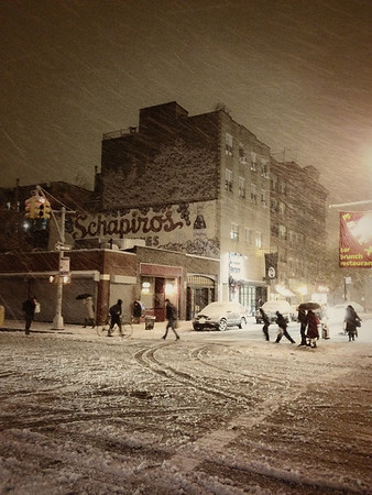 <h2>New York - Snow in the City</h2> - By Vivienne Gucwa<br><br>  People cross a historic street located on the Lower East Side in New York City in the snow. When it snows in New York City, the city resembles a beautiful snow globe especially in this part of Lower Manhattan where old store murals and low buildings dominate the urban landscape.<br><br>  ---<br><br>