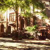 <h2>New York City Townhouses on a Tree-Lined Street </h2> - By Vivienne Gucwa<br><br>  On days like this, it's as if the rest of the world has slipped away with the winter somewhere past the visible horizon into the realm of distant memories. <br><br>  On days like this, the sun exhales through the trees that spread their newly adorned limbs out in a welcoming embrace. <br><br>  On days like this, the city lingers in a promise whispered on a warm breeze.<br><br>  On days like this, the light is a dream that makes its way into reality. <br><br>  On days like this, there is nothing else that matters.<br><br>   ---<br><br>  This image was taken this past weekend as I walked around Manhattan for hours soaking in the gorgeous weather. I have mentioned my severe brownstone envy in other posts before. I believe that townhouses fall under this same category. To re-iterate,  I grew up in Queens (another borough of New York City), and the brownstones in Manhattan and Brooklyn tugged at my heart constantly. Their enormous doorways always seemed to be flanked by extravagant stairways and every window seemed to be a frame encapsulating an enticing painting.<br><br>  There wasn't anything that came close to these beautiful works of architecture where I grew up in Flushing, Queens.  And don't even get me started on the Cosby Show which added to my angsty brownstone envy on a weekly basis. I still stop in my tracks and swoon when I come across a particularly beautiful set of brownstones or townhouses. I imagine all of the narratives that could have possibly occurred in these fantastical works of architecture and it's enough to take me right back to feeling exactly how I did when I was growing up in Queens.<br><br>   ---<br><br>