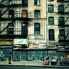 <h2>In Another Place and Time - Chinatown - New York City</h2> - By Vivienne Gucwa<br><br>  New York City changes and evolves at a rapid pace. In certain areas, changes occur faster than others. Lower Manhattan is one place that has changed the most in the last decade. Development happens fast and the current trends are extremely tall buildings constructed mostly of glass, chain stores and luxury boutiques. In neighborhoods that were once bohemian and home to artists and rebels, these current changes have been hard to swallow for long-time residents who run the risk of being out-priced out of the neighborhoods they have called home for decades.<br><br>  Despite these changes, there are still parts of lower Manhattan that recall earlier decades. New York City suffered economically in the 1970s and it was during this decade that much of lower Manhattan was transformed into a danger zone full of abandoned lots and buildings and rampant crime. Having grown up in New York City in the 1980s and early 1990s, I have vivid memories of riding graffiti-covered trains from Queens into Manhattan. I was taught to 'watch my back' at all times since everyone seemed to know someone who had been mugged. Things were still different in those days prior to the initiatives by mayors Koch and Guiliani to 'clean up' the city (and discourse is still rampant regarding how they handled it).<br><br>  When I came across this section of Canal Street initially, my heart almost leaped out of my chest. Here I was staring at a section of a spot in Chinatown that seemed as if it had been dipped in 1980s New York City and had become frozen in time (thankfully I had my camera). It's hard to put into words how powerful this scene is for personally. It's a bit like staring at something that once existed in a distant life.<br><br>  A city may change rapidly discarding pieces of itself, but it's the people who carry it's broken pieces with them in their hearts who imbue the city with its memory.<br><br>  ---<br><br>