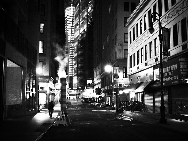 <h2>Smoke - Night - New York City</h2> - By Vivienne Gucwa  At night after the multitudes have retreated to their homes away from the buildings and streets that hold them close during the day the city relaxes shaking the dust of the long day from its concrete limbs.  The street lights flicker like dream-heavy blinks of an eye while smokestacks exhale world-weary breaths of smoke into the yawning night air.  ---