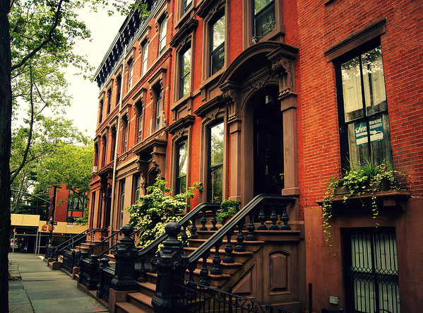 <h2>Cobble Hill Brownstone - Brooklyn - New York City</h2> - By Vivienne Gucwa  I had severe brownstone envy when I was younger. Growing up in Queens (another borough of New York City), I visited Brooklyn frequently and the brownstones found in Brooklyn tugged at my heart. Their ornate doorways were flanked by enormous and extravagant stairways and every window seemed to be a frame encapsulating an enticing painting.  There wasn't anything that came close to these beautiful works of architecture where I grew up in Queens. Watching the Cosby Show fueled my envy of course. I had no idea at the time that the exterior shots of the Cosby's brownstone were shot in Greenwich Village and not in Brooklyn Heights where the Cosby's fictional residence was located (why they did this is beyond me since Brooklyn Heights has some of the most beautiful brownstones). All I knew was that these masterpieces of architecture just seemed more 'New York City' than any of the buildings I grew up surrounded by.  ---